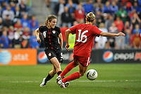 USWNT midfielder Heather O'Reilly (9) makes a pass.....USWNT played to a 1-1 tie with Canada at LIVESTRONG Sporting Park, Kansas City, Kansas.