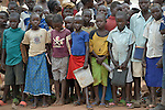 Children line up before class in a school in the Ajuong Thok Refugee Camp in South Sudan. Situated in northern Unity State, the camp hosts thousands of refugees from the Nuba Mountains, located across the nearby border with Sudan. The Lutheran World Federation, a member of the ACT Alliance, provides a variety of services in the camp, including support for children's education.