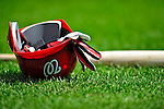 24 May 2009: A Washington Nationals Batting Helmet lies on the infield turf prior to a game against the Baltimore Orioles at Nationals Park in Washington, DC. The Nationals rallied to defeat the Orioles 8-5 and salvage one win of their interleague series. Mandatory Credit: Ed Wolfstein Photo