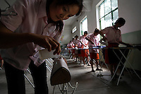 Fuping Vocational Skills Training School... In Eastern Beijing, Tongzhou District.  Main contact is Luan ShunXi +86 136 1104 7569  Email is l1955s7x30@yahoo.com.cn..Girls from rural countryside learning to be maids for the newly wealthy class.  They learn to cook and iron.  Main girls in photos of cooking class are:.Liu Dandan She is in foreground of class.Yin Tingli She is in middle ground showing fear of splattering grease...Li Lingping is the other one responding to the flying grease... she is more in the middle of the class with a scrunched up face.....Fixer is Maggie Shen.+86139 1189 4060