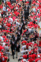 Members of the Ohio State football team walk to the Stadium from St. John Arena before the start of a football game between the Ohio State Buckeyes and the San Diego State Aztecs on Sept. 7, 2013 at Ohio Stadium. (Columbus Dispatch photo by Fred Squillante)
