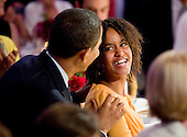 Washington, DC - July 21, 2009 -- Malia Obama smiles at her father United States President Barack Obama during an event celebrating country music in the East Room of the White House in Washington DC, USA on 21 July 2009. Artists scheduled to perform included Charley Pride, Brad Paisley and Alison Krauss and Union Station. .Credit: Matthew Cavanaugh / Pool via CNP