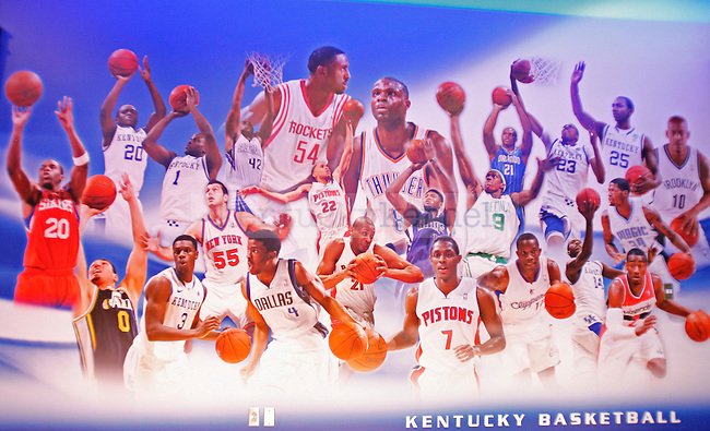 A mural of former UK players in their professional jerseys is on the wall in the new locker room at Rupp Arena in Lexington, Ky., on Tuesday, January 8, 2013. Photo by Tessa Lighty | Staff