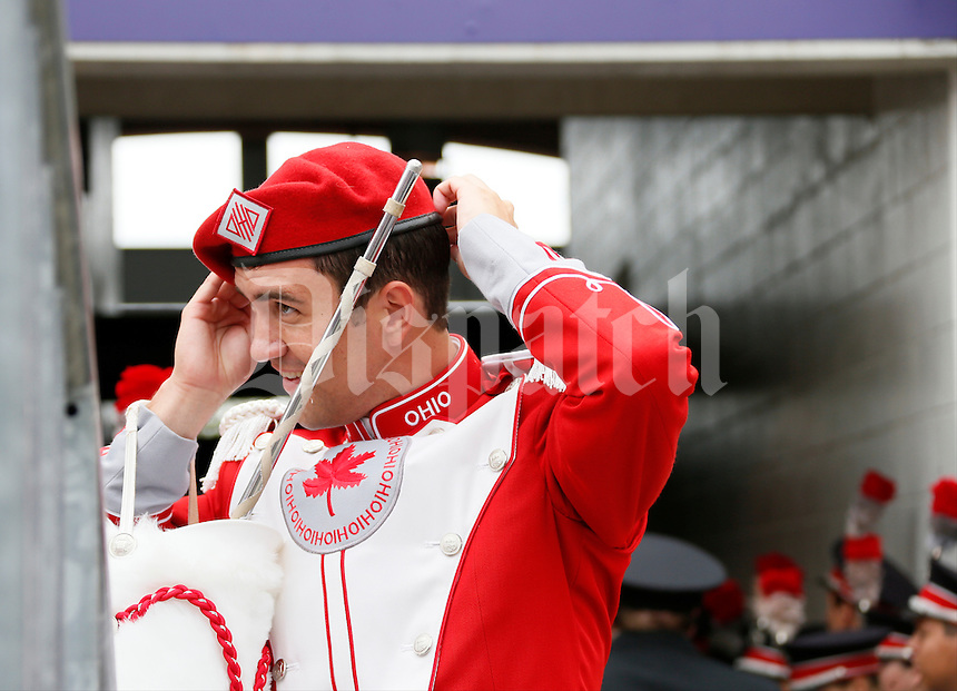 Nathan MacMaster, assistant drum major for the Ohio State University Marching Band, straightens his beret  before Saturday's NCAA Division I football game at M&T Bank Stadium in Baltimore on August 30, 2014. (Dispatch Photo by Barbara J. Perenic)