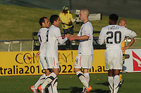 American midfielder Michael Bradely congratulates Landon Donovan and Hercules Gomez as they teammed up to score in the third minute of stoppage time. The U.S. won the match over Australia, 3-1, played June 5th, in Ruimsig Stadium,  at Roodepoort, South Africa.