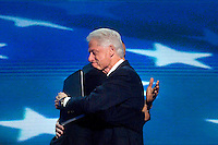 CHARLOTTE, NC - September 5, 2012 - President Barack Obama comes out from backstage and hugs former President Bill Clinton at the 2012 Democratic National Convention.