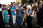 """Filmmaker George Lucas is embraced by a spectator before the American Graffiti Parade in Modesto, California, June 7, 2013. Modesto is celebrating the 40th anniversary of the film """"American Graffiti"""", with a parade headed up by native son, filmmaker George Lucas."""