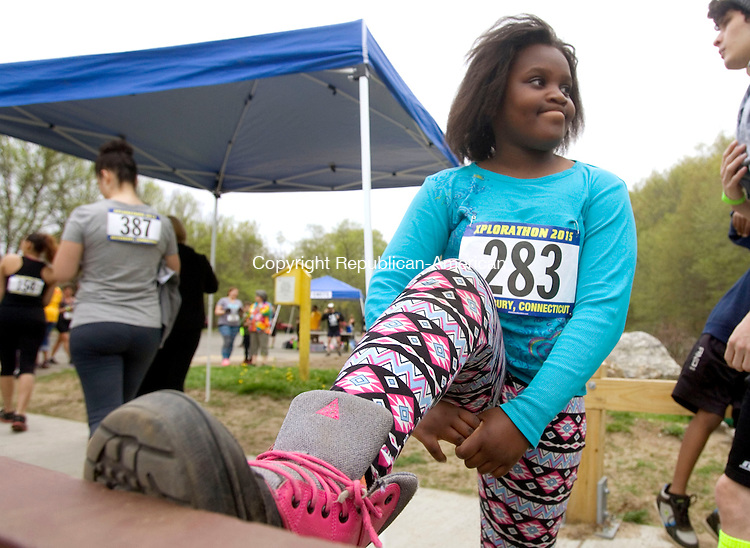 MIDDLEBURY CT. 09 May 2015-050915SV01-Maxine Ragland, 9, of Waterbury gets ready to run the Xplorathon 2015 5k run/jog or walk at Hop Brook State Park in Middlebury Saturday.  The race was 3.1 mile long with obstacles that were mixed in throughout the trail. Proceeds of the event will benefit the children of the Waterbury Police Explorers. <br /> Steven Valenti Republican-American