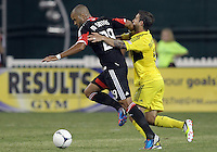 WASHINGTON, DC - AUGUST 4, 2012:  Maicon Santos (29) of DC United struggles to get away from Carlos Mendes (4) of the Columbus Crew during an MLS match at RFK Stadium in Washington DC on August 4. United won 1-0.