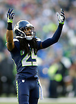 Seattle Seahawks cornerback Richard Sherman plays to the crowd during their game against the San Francisco 49ers  during the quarter  at CenturyLink Field in Seattle, Washington on December 14, 2014.  The Seahawks beat the 49ers 17-7.    © 2014. Jim Bryant Photo. All Rights Reserved.
