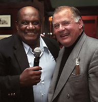 Former Green Bay Packers Willie Davis and Jerry Kramer during the auction portion of the Lombardi Legends Reunion mixer at Lombardi's Steakhouse in Appleton, Wisconsin in September of 2001.