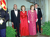 "Washington, DC - (FILE) -- Denis Thatcher, first lady Nancy Reagan, Prime Minister Margaret Thatcher of Great Britain, and United States President Ronald Reagan pose for the ""Grand Staircase"" photo at the White House in Washington, D.C. prior the dinner in the Prime Minister's honor on Wednesday, November 16, 1988.  .Credit: Ron Sachs / CNP"