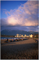 Kitsilano Beach, with towers of the West End of Vancouver bathed in winter sunlight, and the mountains of North Vancouver visible in the background.