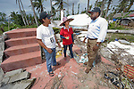 John Nduna (right), the general secretary of the ACT Alliance, visits Jimanoc Island, part of the municipality of Basey in the Philippines province of Samar that was hit hard by Typhoon Haiyan in November 2013. The storm was known locally as Yolanda. here he talks with Joselito Sosmeña, a relief official for the National Council of Churches in the Philippines, and Cherry Llegoa, head of the island's women's association. The ACT Alliance has been providing a variety of forms of assistance to survivors here, and Nduna and other ACT Alliance leaders spent several days in this and other affected communities learning first hand about the network's emergency response and long-term plans for recovery and rehabilitation.