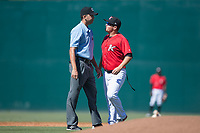 Kannapolis Intimidators manager Justin Jirschele (9) argues a call with base umpire Emil Jimenez during the game against the Asheville Tourists at Kannapolis Intimidators Stadium on May 7, 2017 in Kannapolis, North Carolina.  The Tourists defeated the Intimidators 4-1.  (Brian Westerholt/Four Seam Images)