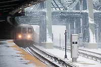 "A subway train arrives at the Smith Street-9th Street station on the elevated portion of the IND line in the Gowanus neighborhood of Brooklyn in New York during a snow storm on Tuesday, January 21, 2014. The city is expected to receive between 8 and 14 inches of snow with brutal ""Polar Express"" temperatures in the single digits. The snow will taper off by Wednesday morning but the arctic temperatures are expected to last several days.  (© Richard B. Levine)"