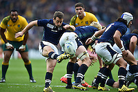 Greig Laidlaw of Scotland box-kicks the ball. Rugby World Cup Quarter Final between Australia and Scotland on October 18, 2015 at Twickenham Stadium in London, England. Photo by: Patrick Khachfe / Onside Images