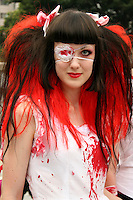Costume Play Bloody Brunette Nurse - A wide variety of &quot;costume play&quot; getups from nurses, bloddy nurses,  goths, cartoon characters from Japanese manga and anime...Every Sunday cosplayers meet up in Harajuku, Tokyo's fashion quarter and show their latest creations. Casual observers think that cos-play is a reaction to the rigid rules of Japanese society. But since so many cosplay girls Tokyo's fashion district HQ for Fendi, Hanae Mori and Issey Miyake, others consider it is a reaction to high fashion.  You can't help but imagine what they wear on Monday mornings though.