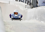 8 January 2016: Anne O'Shea, competing for the United States of America, crosses the finish line on her first run of the BMW IBSF World Cup Skeleton race at the Olympic Sports Track in Lake Placid, New York, USA. Anne took first place with a two-run combined time of 1:50.34 for the day. Mandatory Credit: Ed Wolfstein Photo *** RAW (NEF) Image File Available ***