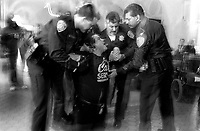 Anti-war protester be arrested at a sitin on the UC Berkeley campus. California, USA<br />