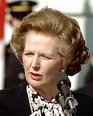 Washington, DC - (FILE) -- Prime Minister Margaret Thatcher of Great Britain, left, makes a statement following her 2 hour meeting with United States President Ronald Reagan (not pictured) outside the Diplomatic Entrance of the White House  in Washington, D.C. on Wednesday, February 20, 1985.  Mrs. Thatcher was in Washington for two days of talks with high administration officials..Credit: Arnie Sachs / CNP