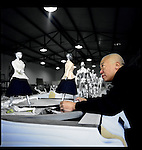Xu Zhongmin examines statue cloaked in a Dior design he has prepared for an installation for an upcoming show sponsored by Dior, Beijing, China.