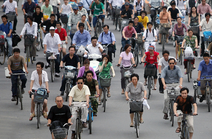 Cyclists make their way home from work on a central Beijing avenue June 30, 2006. China was once known as the 'kingdom of bicycles' but forty per cent of China's oil consumption now goes in to automobiles and that number is expected to grow to about 60 per cent in the next 10-20 years, to roughly the same level as the United States.