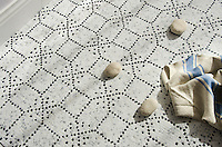 Augustine, a hand-cut stone mosaic, shown in hand-chopped tumbled Calacatta Tia and Nero Marquina, was designed by Paul Schatz as part of the Legend Collection by New Ravenna.