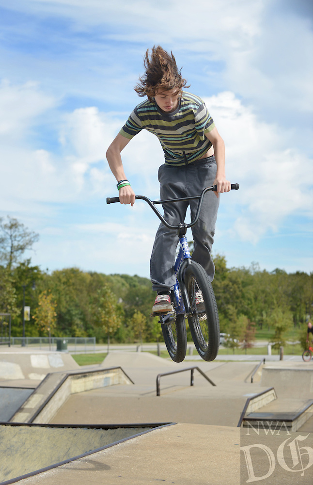 NWA Democrat-Gazette/BEN GOFF @NWABENGOFF<br /> Trace McRell of Springfield, Mo. performs a 360 spin on Sunday Oct. 10, 2016 while riding at the skate park at Memorial Park in Bentonville.