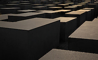 Memorial to the Murdered Jews of Europe, or Denkmal fur die ermordeten Juden Europas, a memorial in Berlin to the Jewish victims of the Holocaust, designed by architect Peter Eisenman and engineer Buro Happold, opened in 2005, Friedrichstadt, Berlin, Germany. The monument consists of 2711 concrete stelae of different heights arranged in a grid over a sloping site and the information centre contains a list of the names of all known Jewish holocaust victims. Picture by Manuel Cohen