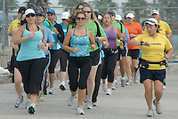 Members of the  L.A. Leggers run along the Santa Monica Boardwalk on Saturday, September 3, 2011. The runners are training for the 2012 Los Angeles Marathon which is expected to take place on March 18, 2012. L.A. Leggers is a non-profit, volunteer-run organization. Their membership includes runners, walkers and volunteer with diverse backgrounds and experience. The organization offers members training and an educational program that enables individuals to attain their own personal goals and objectives. By following their training program, ordinary people can complete an extraordinary challenge - finishing a 1/2 or full marathon.