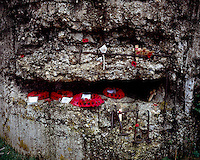 Remembrance poppies decorate a concrete World War I bunker at Hill 60 close to Zillebeke, Ypres.