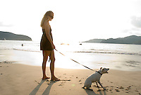 Claudia and Coco the dog on the beach in Zihuatanejo. photo shoot in Zihua with Federico Rigoletti and family, Diego Garcia and his daughters, and the Wiseman family as part of the Puntarena cook book