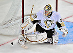 21 September 2009: Pittsburgh Penguins' goaltender John Curry makes a third period save during a pre-season game against the Montreal Canadiens at the Bell Centre in Montreal, Quebec, Canada. The Canadiens edged out the defending Stanley Cup Champions 4-3. Mandatory Credit: Ed Wolfstein Photo