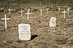 Headstones and crosses, historic early 1900s cemetery, Goldfield, Nevada..General James Murphy and James J. Murphy.