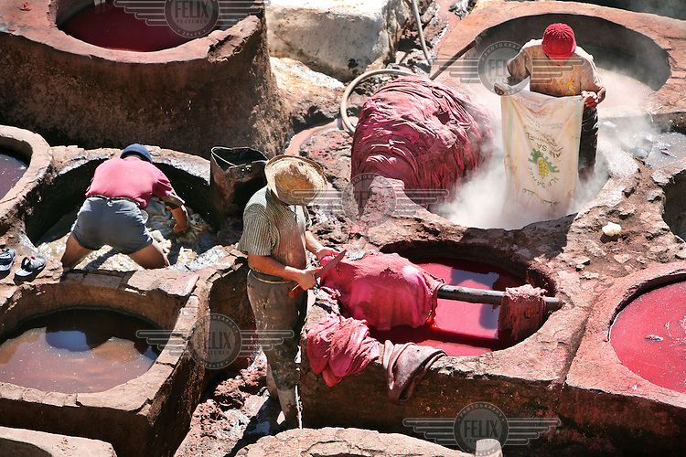 The chouwara tannery of Fes where animal hides are turned into soft colourful leather, a process that has remained unchanged since medieval times. This is the largest and busiest of the four traditional tanneries still operating in the medina. Sheep, goat, cow and camel skins are cured, stretched, scraped and dyed in numerous honeycombed earthen pits in a process that is still as manual as when it began in the 13th century. .