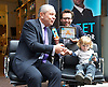 Lord Alan Sugar with Tom <br /> Pellereau (Winner of The Apprentice 2011) as they launch their latest product - the Nipper Clipper - in Neal's Yard, Covent Garden, London, Great Britain <br /> 18th June 2013 <br /> <br /> Tom Pellereau<br /> Lord Alan Sugar <br /> Rem Butler aged 2.5 yrs <br /> and <br /> Jack Pellereau - Tom new born baby aged 12 days old. <br /> <br /> Photograph by Elliott Franks