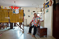 """Baron Divavesi Waqa, the opposition leader. .He says he is victim to """"Paba"""", a Nauruan tradition that allows any relative to come into your house and take anything they like, whenever you have had something good that happened in your life (like a promotion in your job, a birth, birthday etc). Therefore, he says, the interior of his house is quite empty...Nauru, officially the Republic of Nauru is an island nation in Micronesia in the South Pacific.  Nauru was declared independent in 1968 and it is the world's smallest independent republic, covering just 21square kilometers..Nauru is a phosphate rock island and its economy depends almost entirely on the phosphate deposits that originate from the droppings of sea birds. Following its exploitation it briefly boasted the highest per-capita income enjoyed by any sovereign state in the world during the late 1960s and early 1970s..In the 1990s, when the phosphate reserves were partly exhausted the government resorted to unusual measures. Nauru briefly became a tax haven and illegal money laundering centre. From 2001 to 2008, it accepted aid from the Australian government in exchange for housing a Nauru detention centre, with refugees from various countries including Afghanistan and Iraq..Most necessities are imported on the island..Nauru has parliamentary system of government. It had 17 changes of administration between 1989 and 2003. In December 2007, former weight lifting medallist Marcus Stephen became the President."""