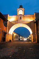 Antigua, Guatemala, March 2012. The famous arch of Antigua. Antigua is a city in the central highlands of Guatemala situated under the Agua volcano famous for its well-preserved Spanish Mudéjar-influenced Baroque architecture as well as a number of spectacular ruins of colonial churches. The old center is filled with boutique hotels, restaurants and shops with local products.  It has been designated a UNESCO World Heritage Site. Guatemala is a great country to experiencce the Mayan lifestyle and see the ruins of ancient cultures. Photo by Frits Meyst/Adventure4ever.com