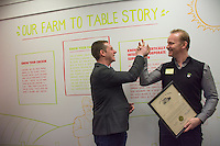 Wolf Starr of Connect Columbus high fives Morgan Spurlock after presenting his with a proclamation from the state of Ohio congratulating him on the opening of his new restaurant.<br /> <br /> Morgan Spurlock opens &quot;Holy Chicken,&quot; a faux fast food restaurant in Columbus, Ohio, where a documentary crew recorded his interaction with customers who thought they were dining at a new type of fast food restaurant. However, the entire location was designed to be part of his documentary highlighting the marketing of food that may not be as healthy as it is stated in advertisement, banners, and notices at the restaurant.