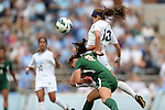 30 September 2012: UNC's Reilly Parker (13) heads the ball over Miami's Shannon McCarthy (8). The University of North Carolina Tar Heels defeated the University of Miami Hurricanes 6-1 at Fetzer Field in Chapel Hill, North Carolina in a 2012 NCAA Division I Women's Soccer game.
