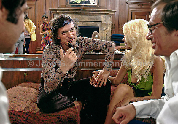 Hugh Hefner with Karen Christy at his Chicago mansion, 1973. Photo by John G. Zimmerman.