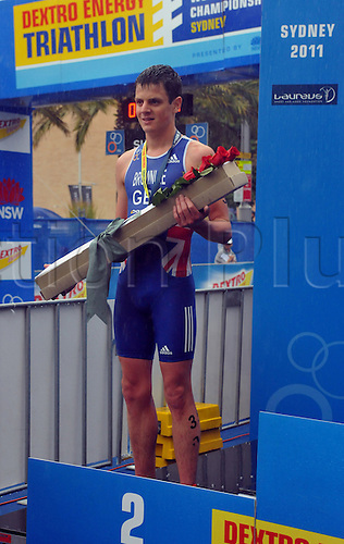 10.04.2011 Dextro Energy Triathlon from Sydney Australia. in Second place is Great Britains Jonathan Brownlee on the Podium