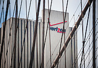 The Verizon building, now known as Intergate Manhattan, seen through the Brooklyn Bridge cables, in Lower Manhattan in New York on Tuesday, May 12, 2015. Verizon Communications announced that it will acquire AOL for approximately $4.4 billion pending regulator approval. (© Richard B. Levine)