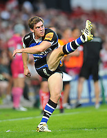 Tom Heathcote kicks for the posts. J.P. Morgan Premiership Rugby 7s match, between Bath Rugby and Exeter Chiefs on July 27, 2012 at Kingsholm Stadium in Gloucester, England. Photo by: Patrick Khachfe / Onside Images