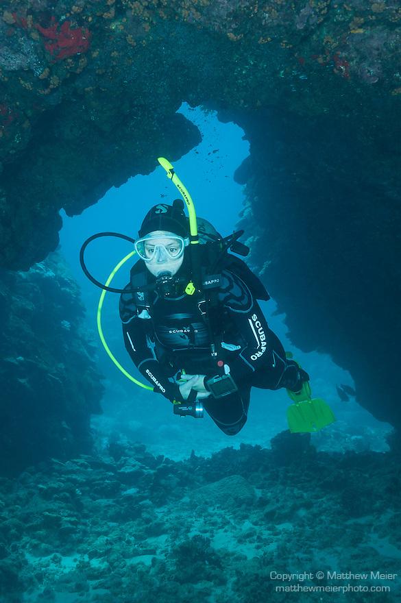 Kona, Big Island of Hawaii, Hawaii; a scuba diver swimming in a lava tube
