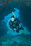 Kona, Big Island of Hawaii, Hawaii; a scuba diver swimming in a lava tube