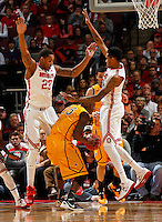 Ohio State Buckeyes center Amir Williams (23) and forward LaQuinton Ross (10) guard Wyoming Cowboys guard Jerron Granberry (15) during the first half of the NCAA basketball game at Value City Arena in Columbus on Nov. 25, 2013. (Adam Cairns / The Columbus Dispatch)