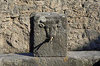 Fountain, Via dell' Abbondanza, Pompeii, with its spout still in place. One of 42 public fountains fed by lead piping from water towers around the city