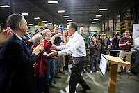 Joanie Scotter greets Republican presidential candidate Mitt Romney at a town hall campaign event on Friday, December 9, 2011 in Cedar Rapids, IA.